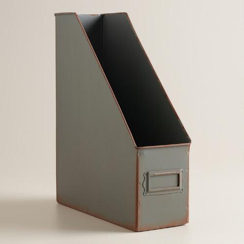 A freestanding magazine holder made of metal mesh with a black finish. Set of 3 Wall Mounted Rustic Black Metal Wire Mail Sorter/Magazine Rack w/Erasable Chalkboard Labels. by MyGift. $ $ 39 99 $ Prime. FREE Shipping on eligible orders. out of 5 stars