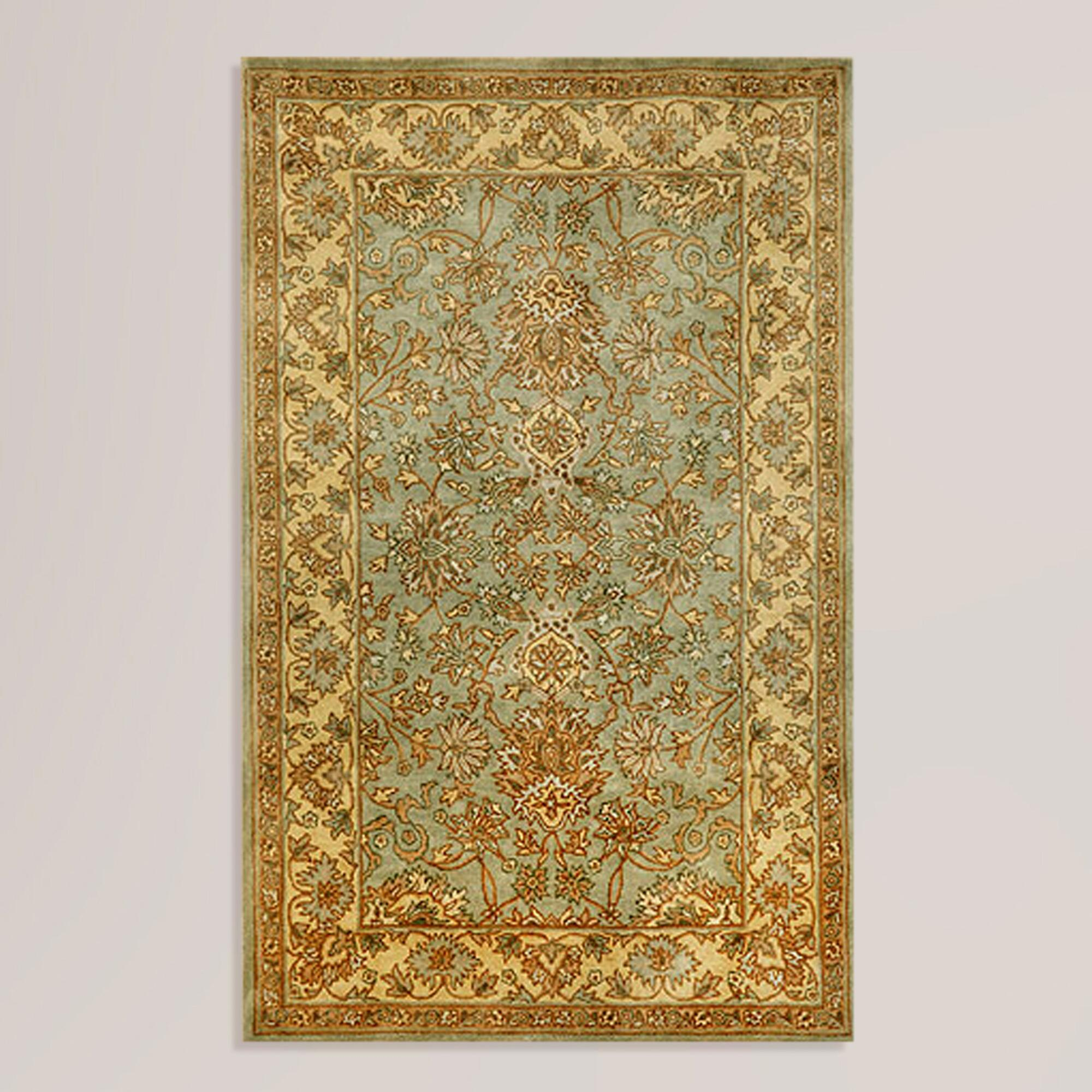 Rugs -Our light blue area rug evokes the artistry of stained glass windows with its geometric tile motif inspired by Persian texti les. Power-loomed from a soft, synthetic yarn, this affordable rug is antimicrobial, stain-resistant and boasts a soothing underfoot feel.