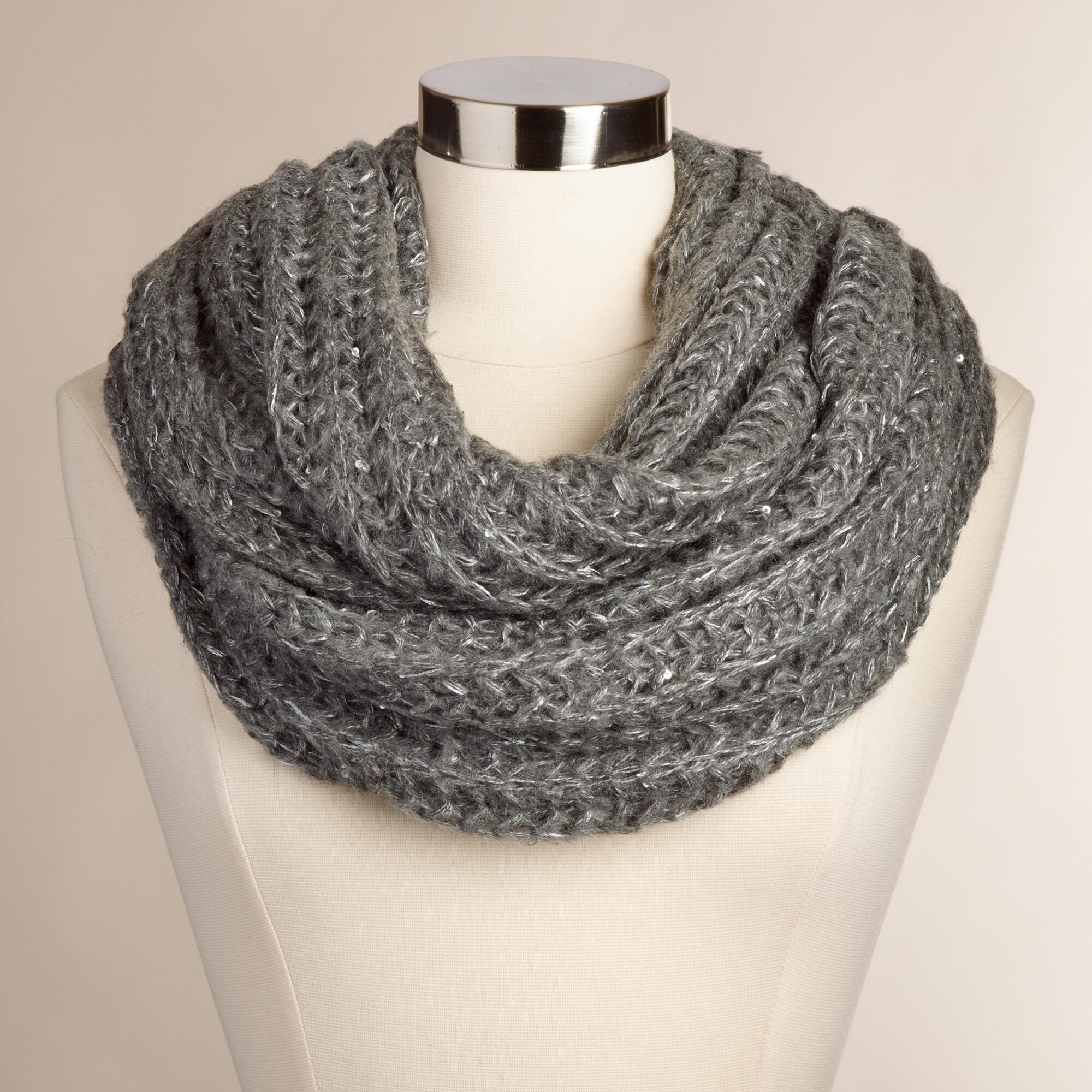 Add a little glam to your cozy with this lurex mix knit tassel infinity scarf in gray!