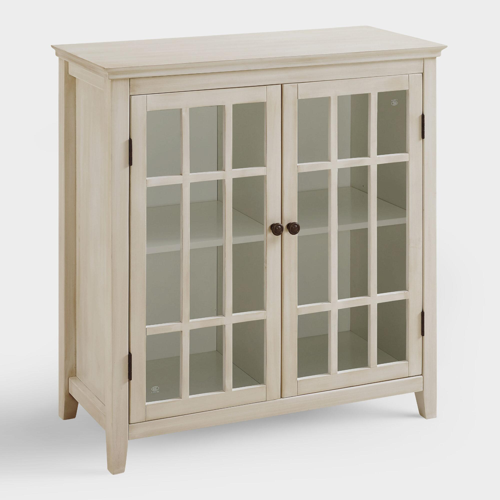 Antique white double door storage cabinet world market for White kitchen storage cabinets with doors