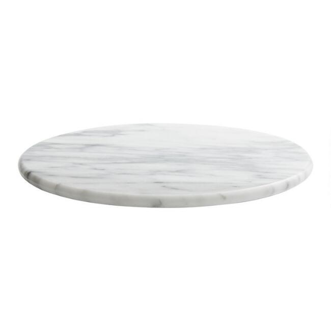 A gorgeous White Marble Lazy  Susan is a low cost high style kitchen essential perfect for entertaining and serving a lovely charcuterie selection! Come discover more French Farmhouse Decor inspired by Fixer Upper and click here to Get the Look of The Club House Kitchen & Sun Room. #fixerupper #joannagaines #kitchendecor #frenchfarmhouse