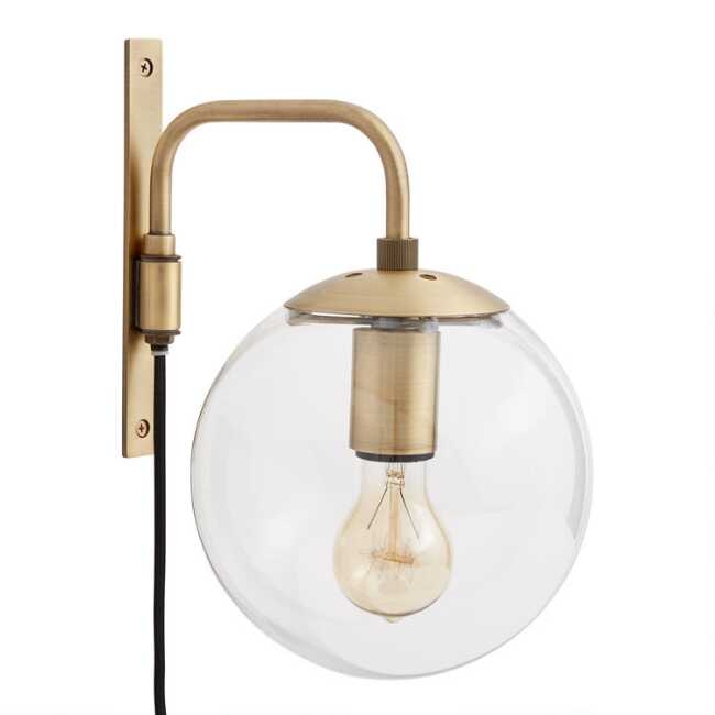 Shop Glass Globe and Brass Wall Sconce from World Market on Openhaus