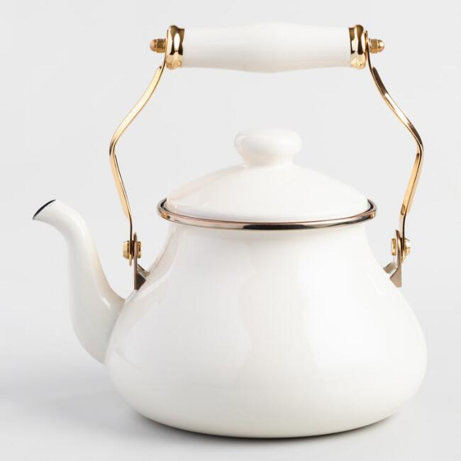 Ivory Enamel Tea Kettle - Come discover more French Farmhouse Decor inspired by Fixer Upper and click here to Get the Look of The Club House Kitchen & Sun Room. #fixerupper #joannagaines #kitchendecor #frenchfarmhouse