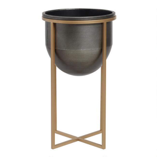 When you want a piece of decor with scale, and modern rustic style but also function...this Blackened Metal Planter on Gold Stand fits the bill!