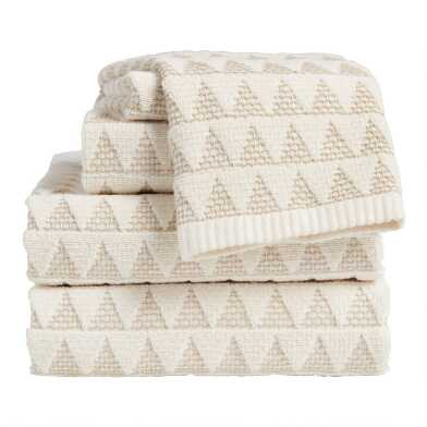 Ivory and Taupe Sculpted Triangle Laken Towel Collection